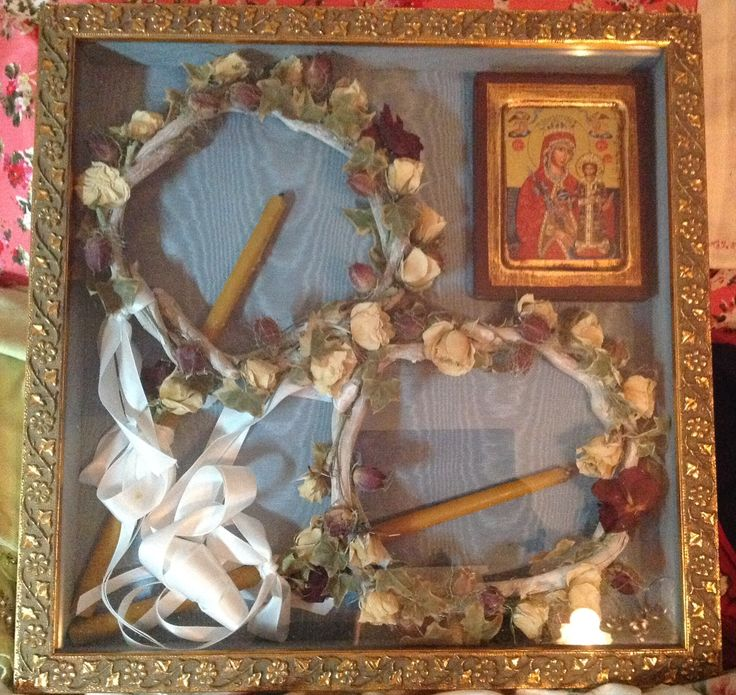 Wedding crowns for an Orthodox Christian Marriage 2016.  Sealed in a box with candles used in the wedding.  Also the icon of the Theotokos and Christ is placed in the box  for the couple.  Most people keep the crowns in their bedroom.  The crowns were dried for two weeks in Borox and cornmeal (only the flowers needed drying but the whole crown was buried in the mixture).