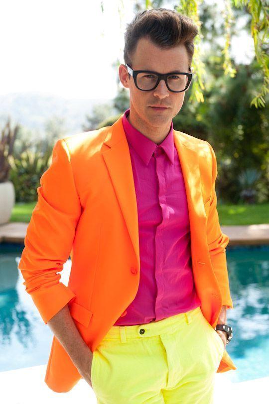 Shop this look on Lookastic:  https://lookastic.com/men/looks/orange-blazer-hot-pink-dress-shirt-yellow-chinos-dark-brown-watch/13025  — Hot Pink Dress Shirt  — Orange Blazer  — Dark Brown Leather Watch  — Yellow Chinos