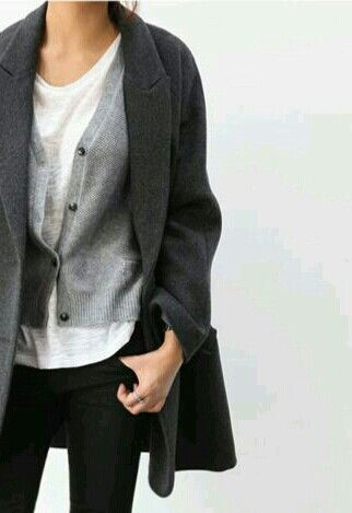 Looking for a minimal, yet classic laid back look? This white t-shirt, gray cardigan, and wool coat combo is the perfect example.