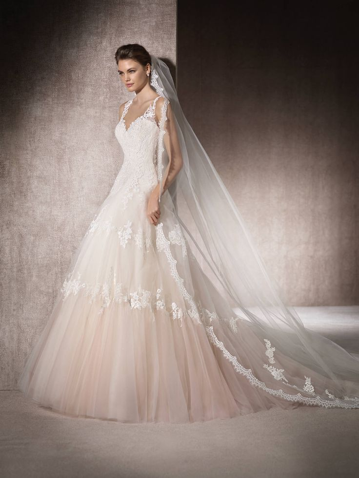 MANUELA is an A-line wedding dress with a sweetheart neckline in shades of degradé pink. In tulle, Chantilly, guipure, gemstone embroidery and thread embroidery