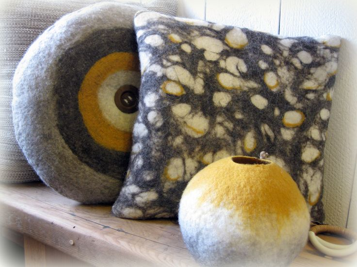Hand felted cushions and vessel