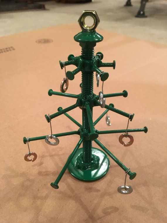 This is a steel Christmas tree made from nuts, bolts, nails, and washers. It is painted green. I make these by hand, so each one is a little different.