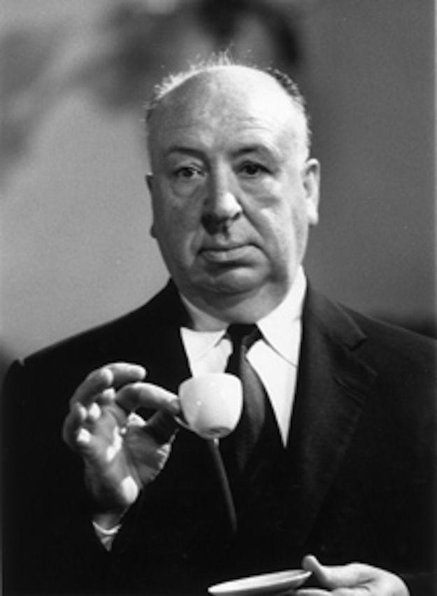 Holding a petite tea cup | 22 Photos Of Alfred Hitchock Being A Big Goof                                                                                                                                                      More