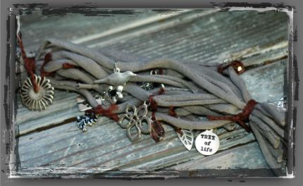 Braclet made out of an old t-shirt and charms!