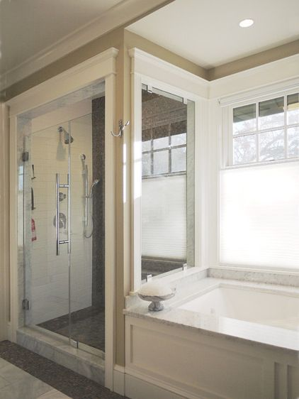 Love this alternative to an all glass shower~craftsman bathroom by Rill Architects