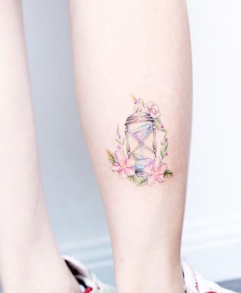Hourglass tattoo by Mini Lau
