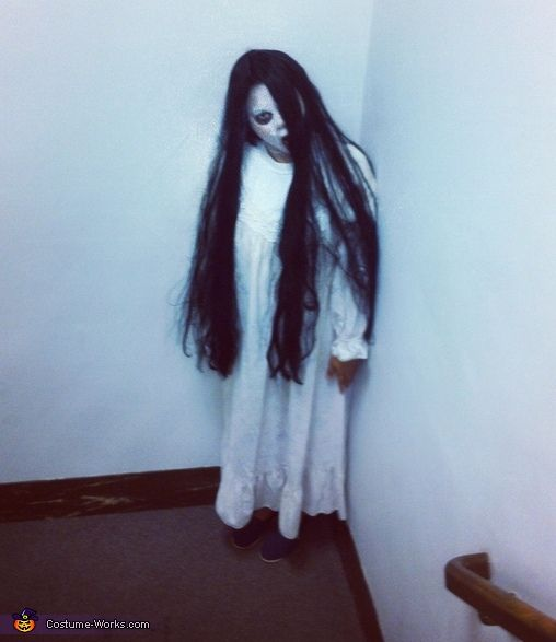 Dressing like Samara Morgan from 'The Ring' is a sure way to draw gasps and screams from partygoers and trick-or-treaters alike on fright night. With a simple nightgown, a long black wig, and menacing makeup, any film fanatic transforms into this ghastly ghoul of a little girl.