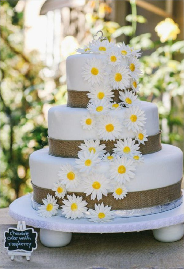 white wedding cake with burlap and flowers / http://www.deerpearlflowers.com/rustic-country-burlap-wedding-cakes/2/