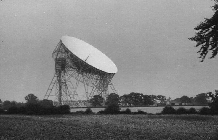 Early photo of Jodrell Bank radio telescope towering above the surrounding Cheshire countryside