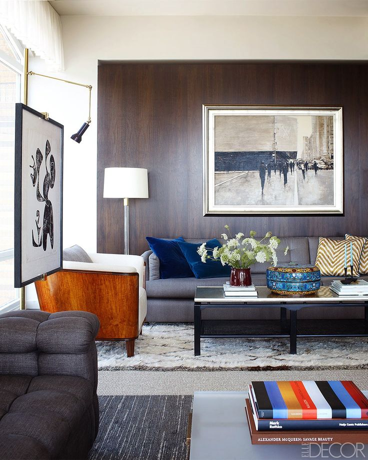 Gray, mixed woods, throw pillows; everything stays light. Design by Shawn Henderson.