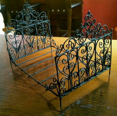 Miniature wrought iron bed