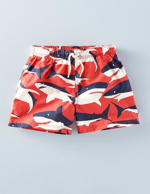 """More sharks! These """"Bathers"""" from Boden's boys department have a mid-thigh length (instead of the typical boys' board shorts that go past the knee). Sizes 2-12."""