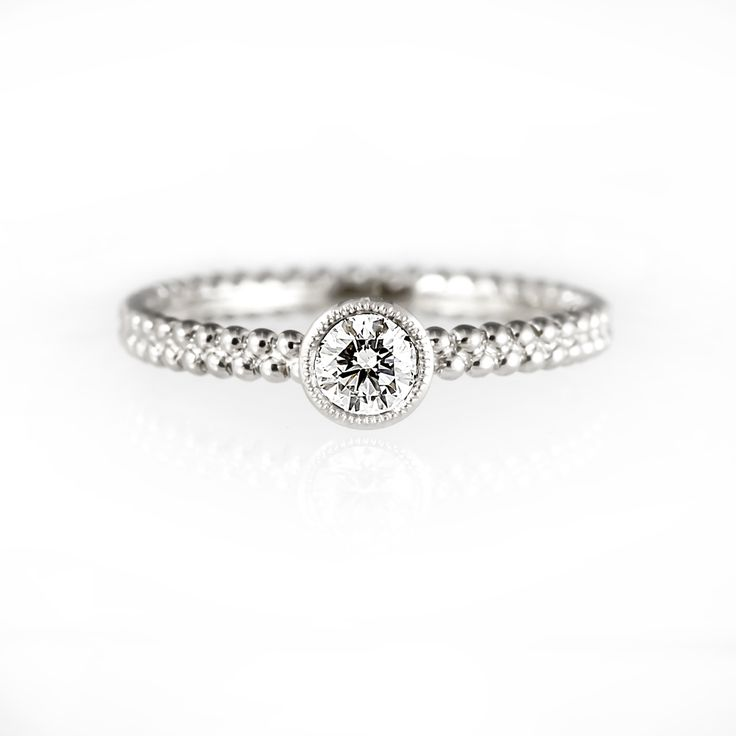 Thin and delicate solitaire engagement ring,
