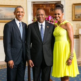 First Lady Michelle Obama Stuns in a Neon Yellow Dress and Chic Topknot at Recent White House Dinner  #InStyle