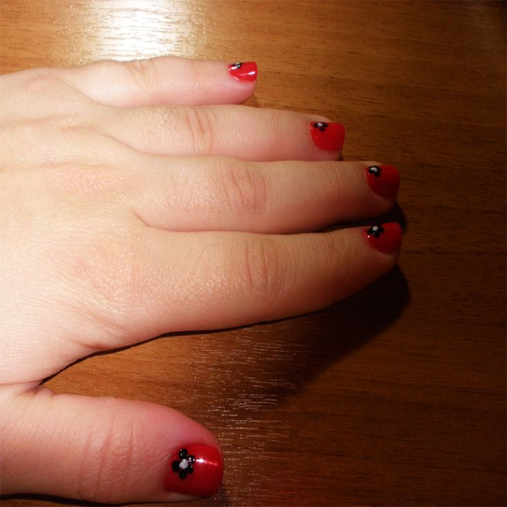 Red nails with black flowers