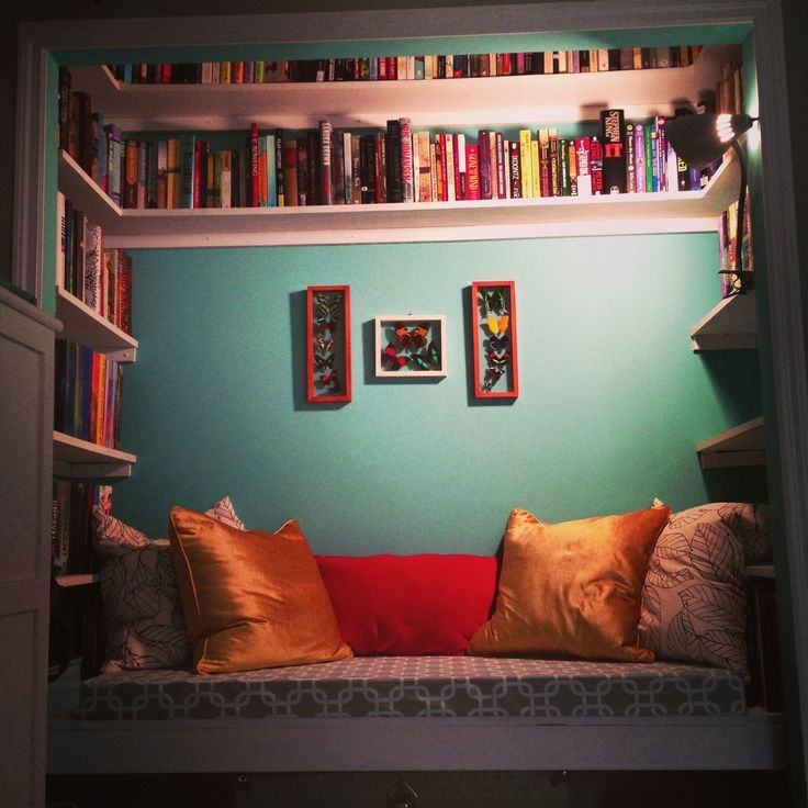 Cool little book nook:) I want lots of these in my dream house:) I especially really like the butterfly display cases on the wall!!