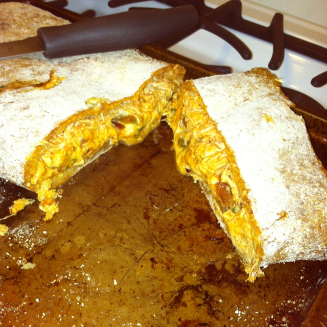 Big hunka Buffalo Chicken Stromboli. Store bought WW pizza dough, sautéed onions and peppers, leftover buffalo chicken, fresh spinach, and mozzarella cheese. Stretch dough out on a well floured surface. Pile on the toppings to your liking. Fold in the sides, then roll over onto itself. Place on a well greased pizza pan. Bake for 20-25 mins at 450 degrees. So yummy. For the chicken I used the recipe for weight watchers crock pot buffalo chicken. Which BTW is delicious all on its own.