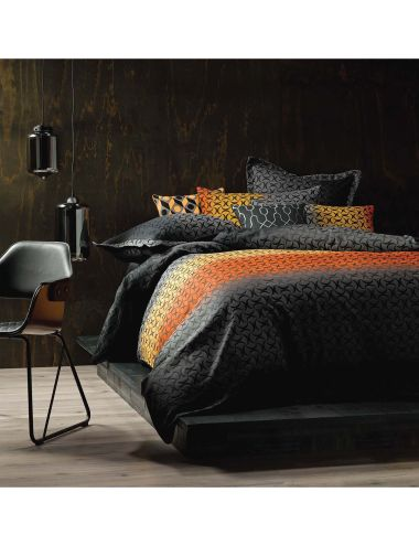Rendered a dark, sunset colour-way with a sophisticated edge, this design is cleverly woven with an ombre effect behind the main geometric all-over motif.