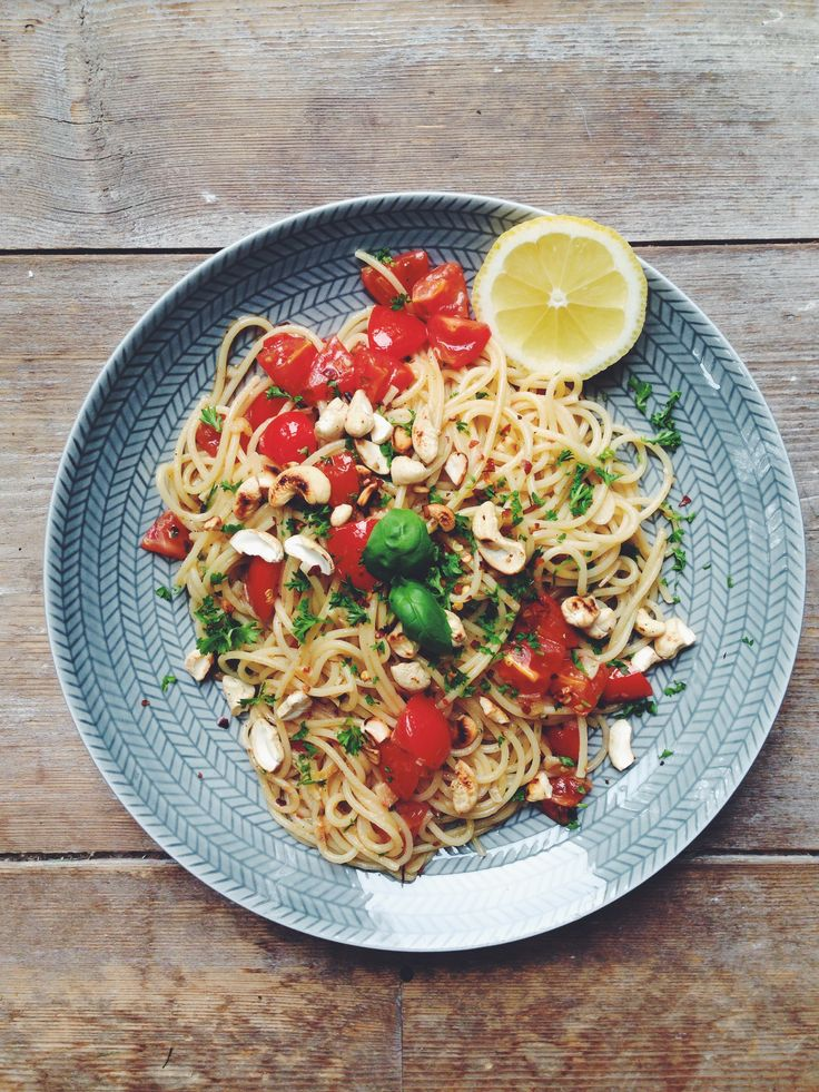 Pasta with tomatoes, cashew nuts, lemon and basil. By @olivehummer