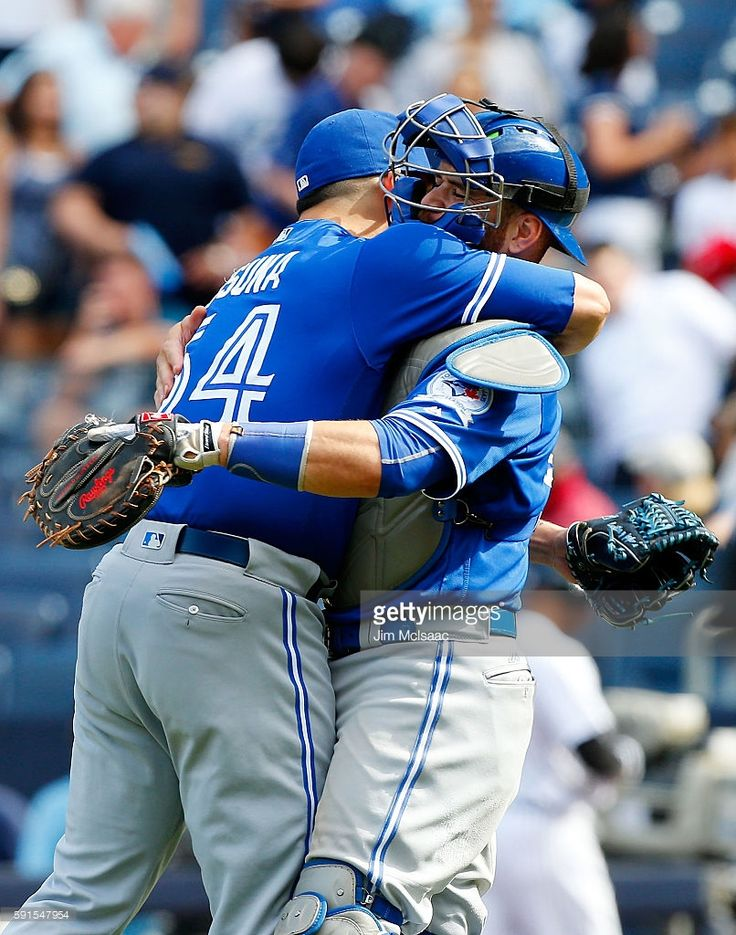 This bromance.  Roberto Osuna #54 and Russell Martin #55 of the Toronto Blue…