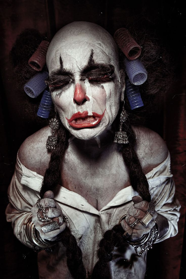 Clownville, a photo series featuring grotesque portraits of terrifying clowns, is the photographic nightmare of French-born photographer Eolo Perfido