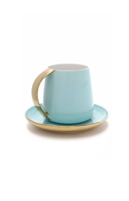 gold and blue cup and saucer