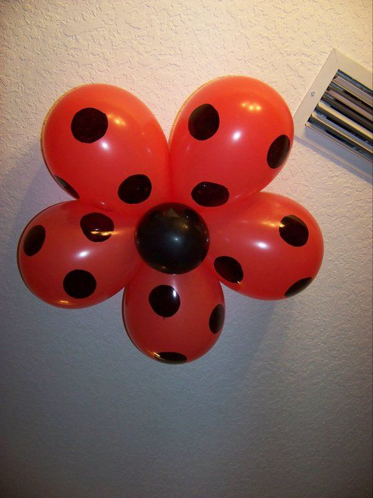 LadyBug Decorated Flowers on the Ceiling - very cute idea...either this or pompoms on the ceiling