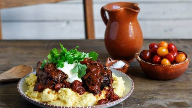 Delicious Mexican beef short ribs served over cheesy polenta