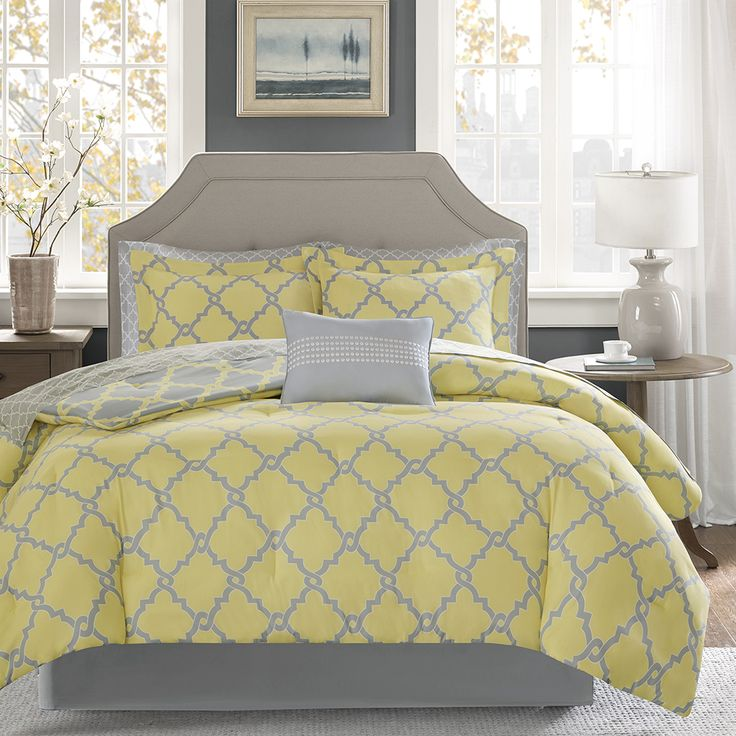 The Madison Park Essentials Merritt Complete Bed and Sheet Set creates a simple yet chic look in your space. The fretwork design creates a modern look with its soft yellow design on a grey base. This set is completely reversible to a soft yellow base with a grey design allowing you to change the feel of your room instantly. A 180 thread count printed sheet set also features a smaller scale fretwork pattern for a finished look.