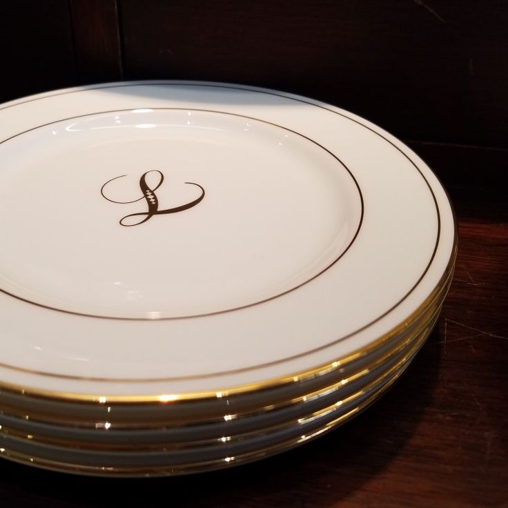 These simply elegant gold initial appetizer plates from Lenox make a perfect gift for newlyweds or housewarming; only $76 for a set of four!  🏡💒🍽  #schomburgs #jewelers #shoplocal #familybusiness #columbusga #shopsmall #lenox #finechina #initial #monogram #gold #appetizer #plates #home #decor #wedding #gift #bridal #registry  #housewarming #gifts
