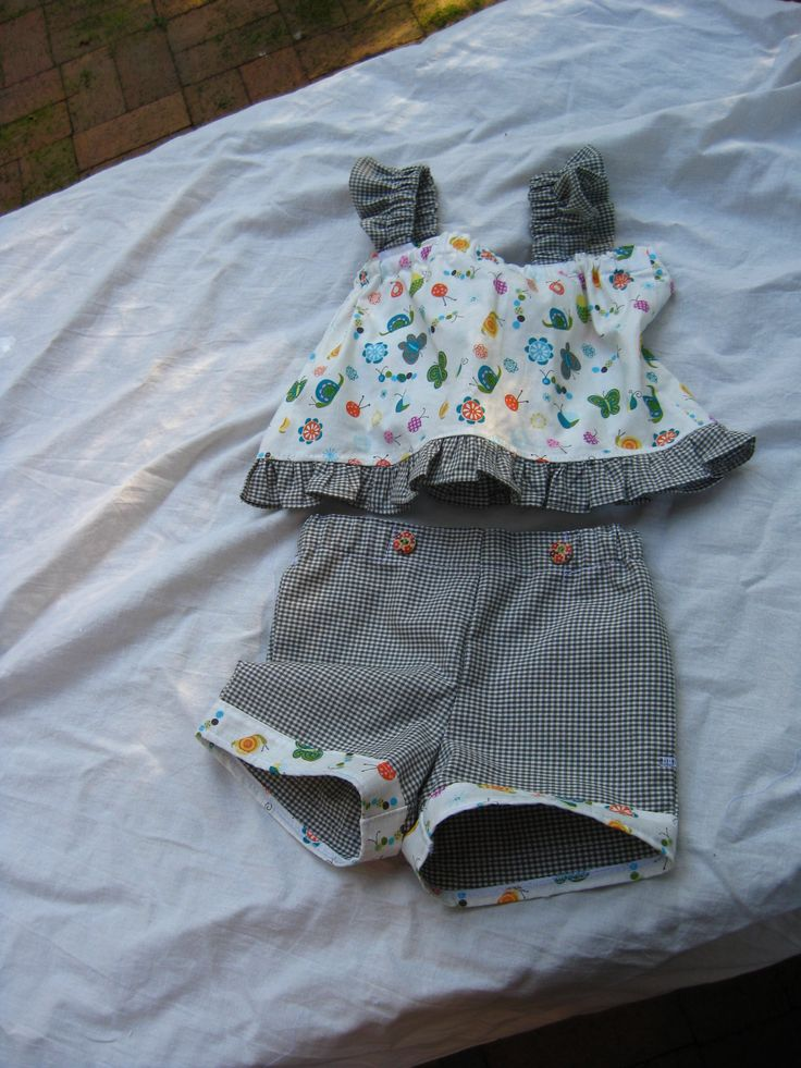 I love the way this one turned out.  Pretty Miss shorts and top available through http://www.thehandcraftedshop.com/babies-amp-toddlers/clothing/pretty-miss-shorts-and-top