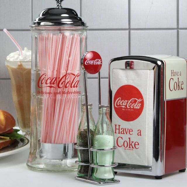 Vintage Kitchen The Coca-Cola Tableware Set has vintage diner style while being durable and made to last. Glass, chrome and stainless steel construction. Set includes a Coke straw dispenser, tall napkin holder, S 1950s Diner, Vintage Diner, Vintage Kitchen, Vintage Style, 50s Diner Kitchen, American Diner Kitchen, Retro Kitchens, Vintage Metal, Straw Dispenser