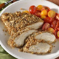 Onion-Crusted Chicken..1 envelope Lipton onion soup mix, 1 c plain breadcrumbs, 2/3 c Hellman's mayonnaise, 8 boneless, skinless chicken breast halves..Preheat oven to 425. Combine onion soup mix with bread crumbs in shallow dish; set aside. Toss chicken with mayonnaise in medium bowl, then dip each coated breast in onion mixture, turning to coat on all sides. Arrange chicken on baking sheet. Bake 20 minutes or until chicken is thoroughly cooked.