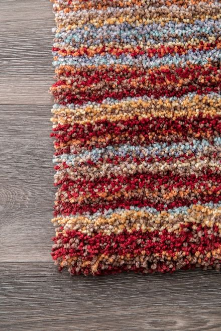 the rugs usa keno striped shaggy rug offers cushiony comfort and casual quality all wrapped into one the plush soft rug features stripes of