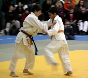 Damien Wiens from the Moose Jaw Koseikan Judo Club, left, and Justin McKay from the Pense Judo Club compete at the Sask Open.