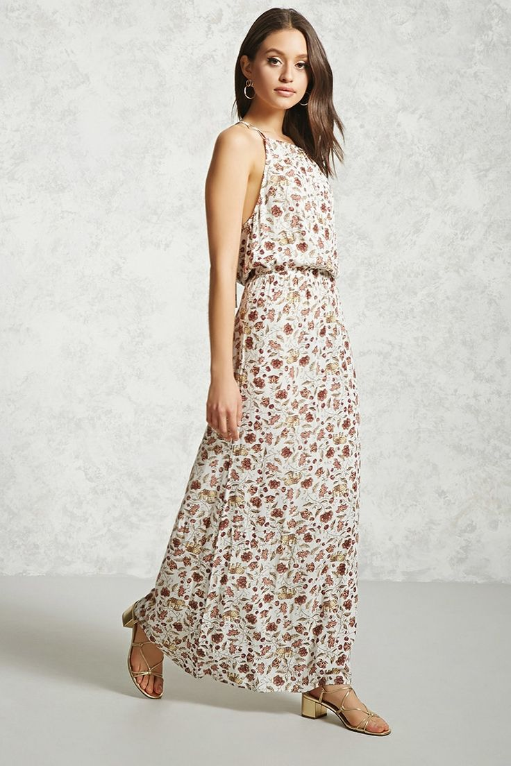 A woven maxi dress featuring an allover floral and ornate elephant print, a self-tie round neck, keyhole back, sleeveless cut, and an elasticized waist.