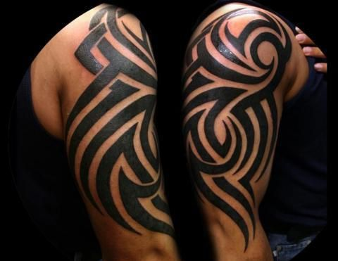 Cool tribal tattoos meaning strength and courage for Strength tattoos on ribs