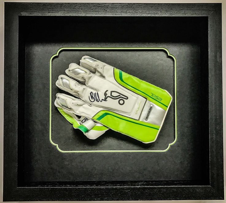 Signed wicket keeper's glove   Lovingly framed by Jules Sainter