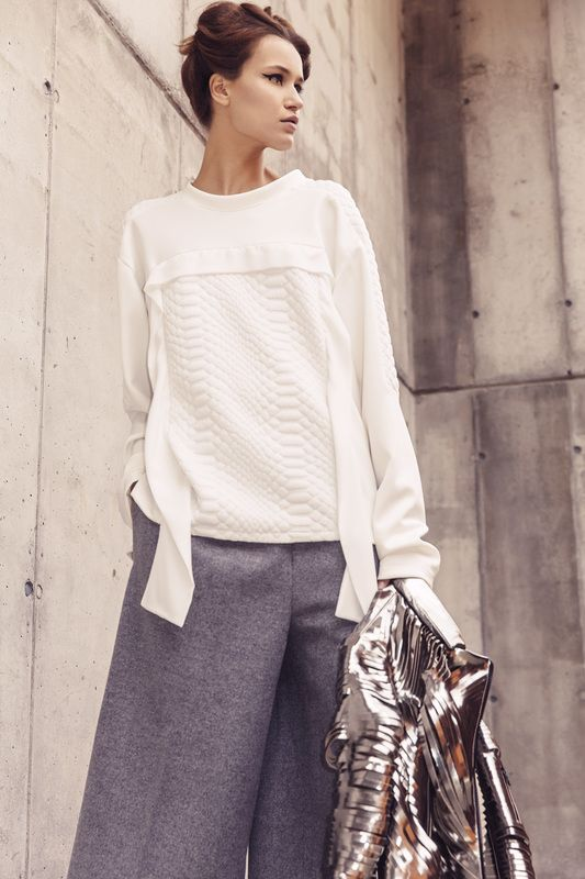 White blouse with snake detail