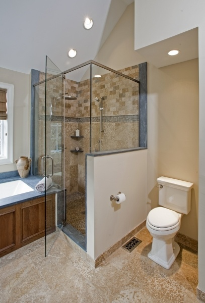 The custom wet bed shower is enclosed with heavy frameless glass for a  sleek look.