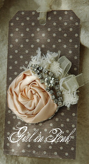 How pretty. Make this into a pin instead of a tag and put it in your cardigan, jacket, scarf, dress...make two into clips and put them on shoes :-)