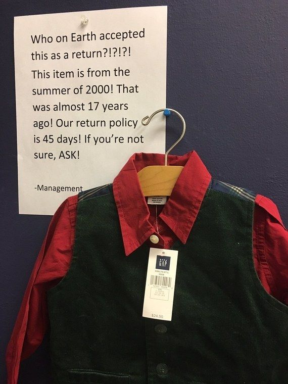 """An image of a BabyGap button-down shirt with an attached checkered vest surfaced online. The XL shirt, priced at $24.50, was hung next to a sign that read, """"Who on Earth accepted this as a return?!?!?!"""" It turns out an unknown customer apparently returned the (now vintage) children's top almost 17 years after it was purchased, way past the company's 45-day return policy."""