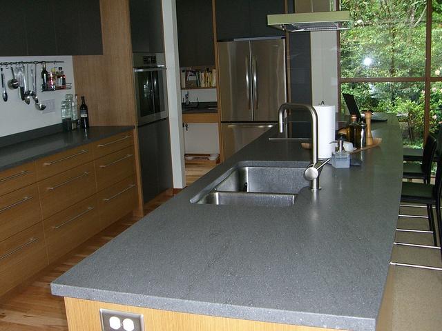 Grey basalt counters with golden oak cabinets kitchen for Kitchen design visit