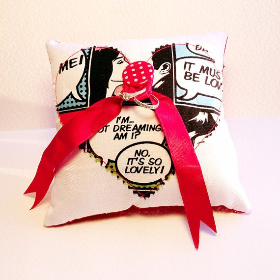 Comic Book Print Geek Wedding Ring Cushion Pillow with Applique Comic Book Fabric Heart and Red Ribbon on Etsy - Screw that - I could totally make this.