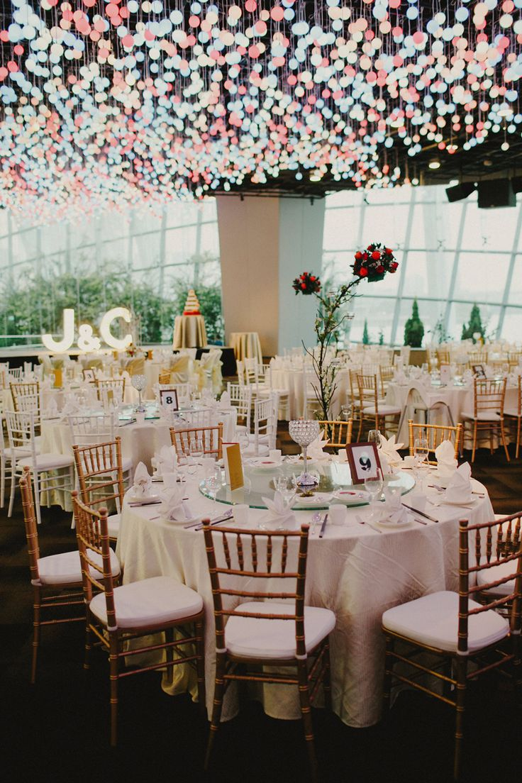 amazing lighting at this wedding reception in flower field hall gardens by the bay