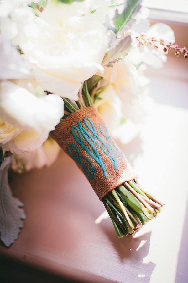 White bouquet with brides initials embroidered in burlap sash (something blue)