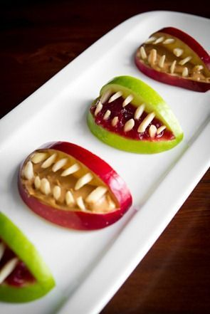 #Halloween apple bites made with peanut butter/jelly and almonds: