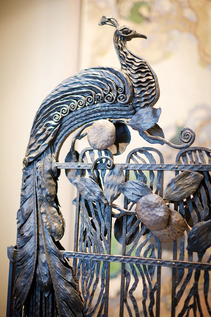 Wrought iron peacock on gate