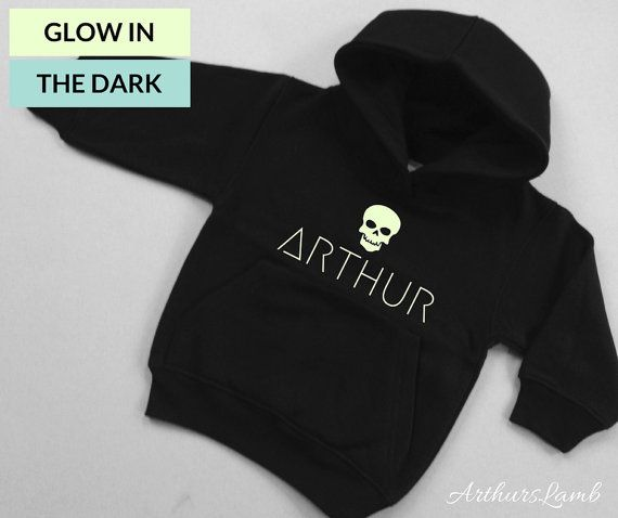 Skulls are everywhere now days, especially at Halloween and on the Day of the Dead!! And with this personalised Glow in the Dark Skull Icon hoodie you are sure to stand out!! So whether you are looking for a something to wear when you go out to trick or treat, a Halloween gift or even a Dia de Muertos outfit, this sweater/jumper personalised with any name will be a much loved addition to the spooky day!! When ordering, please note the name required in Comments to Seller box during checkout…