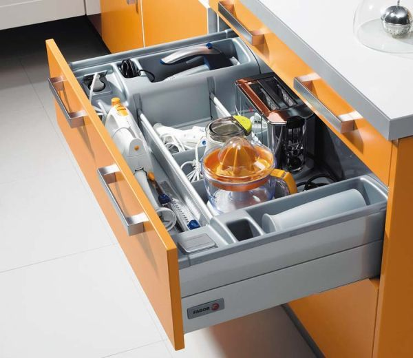 Modern kitchen featuring a drawer organizer with all sorts of storage compartments
